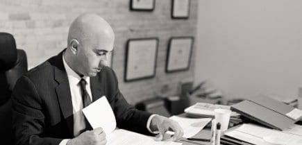 levine law lawyer working at desk