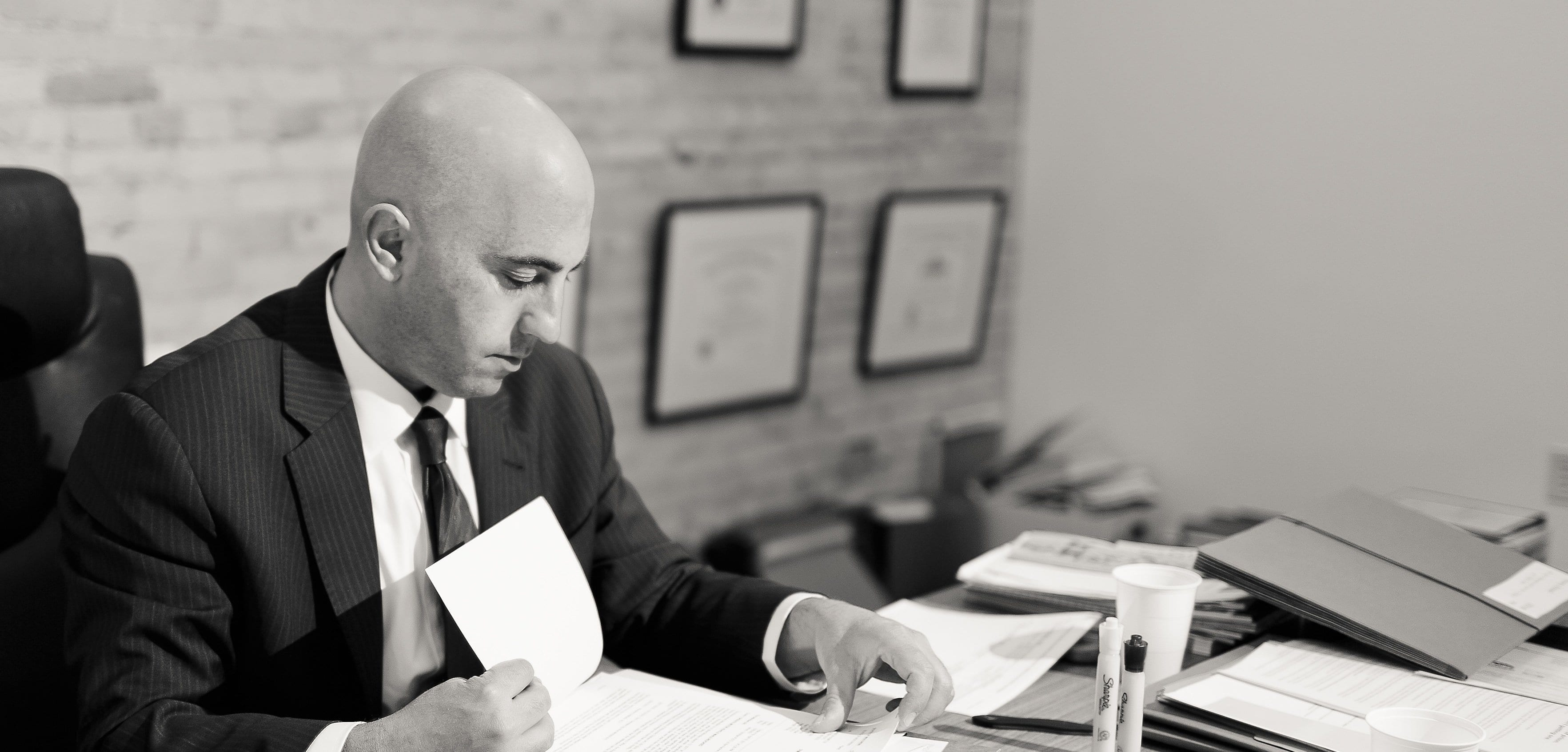 Attorney Michael Levine at work at a desk